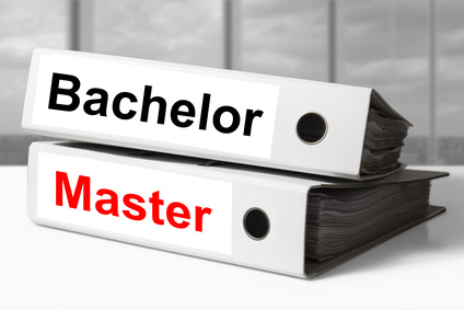 stack of two white office binders bachelor master graduation degree